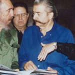 The late great American artist, LeRoy Neiman, discussing with Fidel Castro a Neiman painting of Fidel. 2003.