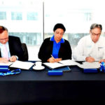 Tom Hall, Chairman of the Florida Aquarium Foundation; Maria de los Angeles, director of the National Aquarium of Cuba; and Thom Stork, President and Chief Executive Officer (CEO) of the Florida Aquarium, signing historic agreement to protect the Coral Reefs of the Gulf of Mexico. 2016.